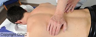 Man treating upper back